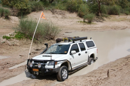 Shaun crossing Eyre Creek (he got stuck on exit - Dad had to winch him out after taking a 10 K detour)